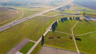 Drone view cars traffic on highway junctions. Beautiful landscape highway interchange. Cars driving on freeway intersection. Interchange highway road. Aerial landscape road junction sign
