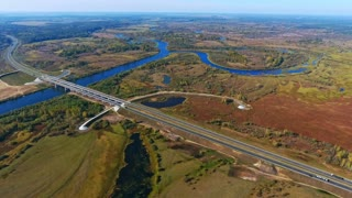 Drone view highway landscape. Highway road above river landscape aerial. Landscape bridge road from birds view. Aerial view road in nature landscape. Aerial highway. Aerial road in field