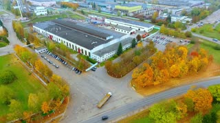 Drone view industrial buildings landscape. Industrial area and car parking aerial view. Autumn view of industry buildings sky view. Industrial buildings in autumn landscape. Factory buildings