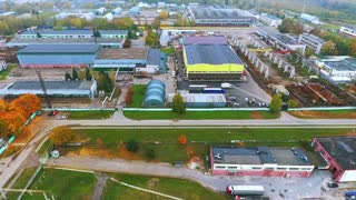 Drone view warehouse area on territory industrial plant. Aerial view production warehouse in factory territory. Industrial buildings on territory industrial city sky view. Industrial cityscape
