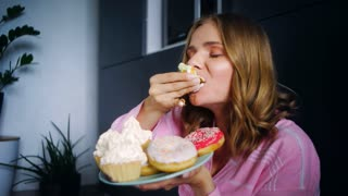 Eating woman enjoy cream cupcake. Food calories. Close up hungry overeating young girl eating cake with big appetite. Portrait of eating girl with sweet cake. Woman tasting sweet cookies