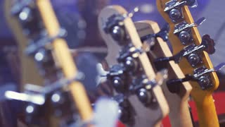 Electric guitar head selective focus. Close up of electric guitar headstock. Electric guitar neck. String instruments. Music guitar headstock. Music instruments background