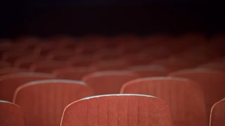 Empty movie theater auditorium with seats. Rows of void seats in cinema. Cinema theatre hall with empty armchairs. Cinema hall with red armchairs. Movie entertainment