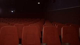 Empty seats in cinema theatre. Red seats in movie theatre. Empty theatre hall with red armchairs. Cinema hall with chairs is ready for visitors