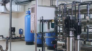 Factory worker control engineering equipment. Man engineer check water purification system. Industry engineer controlling water treatment process. Industrial worker control industry factory equipment