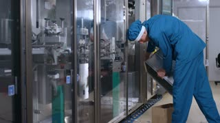 Factory worker service manufacturing equipment. Male operator throw out garbage after production process. Garbage trash at manufacturing line. Factory production process. Pharmaceutical factory