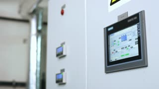 Factory worker touch screen display. Engineer working with industrial computer equipment. Industrial control screen. Close up of control panel screen. Factory man hands touch control monitor