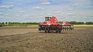 Farming machinery on agricultural field. Rural agriculture equipment. Farming machinery on plow field