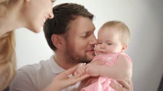Father kissing baby girl. Dad kiss daughter infant at home. Close up of man kissing child in hands. Male tenderness. Happy family together. Portrait of father holding baby girl. Family care child