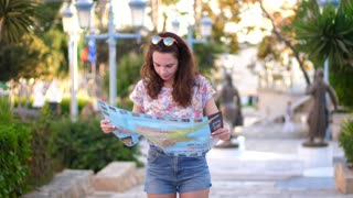 Female tourist looking around. Woman tourist lost alone in tropical city. Girl looking map and search route. Woman looking map. Search travel route