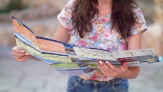Female tourist looking map. Woman looking map. Travel concept. Summer adventure trip. Woman tourist search destination on chart