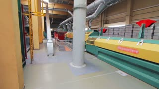 Flax factory working process. Manufacturing line at plant. Automated machine working in plant. Factory line working automatically and nobody around. Flax production process at factory.