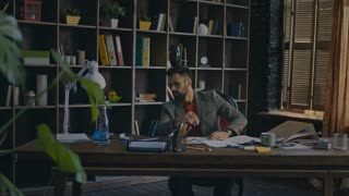Frustrated businessman putting head on desk in home office. Tired businessman sitting at table. Tired at work man rest on desk. Business owner rest in cozy office