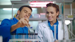 Group of doctors in clinical lab. Female and male doctor laughing in medical lab. Medical laboratory team. Medical researchers discussion laboratory samples. Lab doctors having fun in laboratory