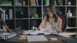 Happy business woman smiling in office. Successful women enjoy work. Satisfied businesswoman finish work. Business success concept. Happy employee collect documents on table