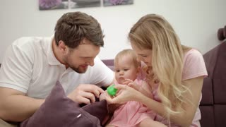 Happy family playing together. Mother and father play with child at home. Togetherness love concept. Joyful family with baby embrace. Enjoy together time. Sweet parenting
