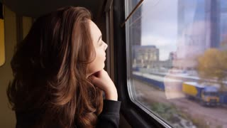 Happy woman face looking window train. Close up of smiling woman enjoy train trip. Female traveler looking window at railway road. Happy tourist enjoy vacation