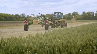 Harvest machine. Agricultural machinery for harvesting moving on farming field. Farming equipment working on agricultural field. Agricultural equipment for harvest cultivation. Farming industry