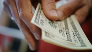 Human hands counting dollar bills. Close up of hands count money cash. American money calculation in bank office. Us dollar money income concept. Finance business concept