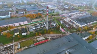 Industrial city drone view. Aerial view boiler pipe in industrial factory territory. Chimneys boiler factory view from above. Industrial plant territory. Manufacturing plant outside