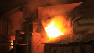 Industrial fire from furnace. Iron and steel industry. Intense industry fire flame. Industrial furnace fire. Steel industry furnace. Steel industrial production