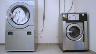 Industrial washer dryer working. Hotel laundry service. Clothes dryer machine. Industrial dryer clothes. Industrial washing machine. Drying laundry washing machine. Washer machine washing