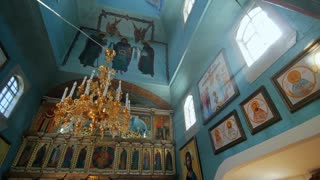 Inside of old orthodox church. Church building interior background. Icons of saint people. Praying hall of religious building
