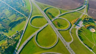 Interchange highway road network. Aerial landscape road crossing. Aerial view road junction. Aerial view highway junction. Drone view highway crossing. Round road view from above