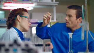 Lab teamwork. Medical scientist working in lab. Lab technician doing medical research. Medical researchers analysing liquid sample. Medical laboratory research. Lab team doing clinical research