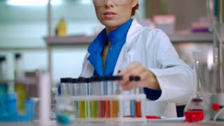 Lab woman working with laboratory glassware. Female lab worker in science laboratory. Lab student doctor working with laboratory flask. Lab researcher working with liquid