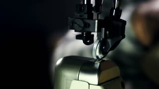 Leather manufacturer starts stitching leather parts. Close up man hands working with sewing machine. Leather stitching professional equipment in workshop. Leather stitching on sewing machine in action