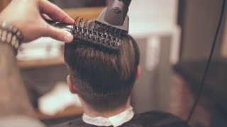 Male hairstyle. Man hair drying in barber shop. Barber styling hair with dryer. Finish hairdressing. Barber hairstyling. Hair dryer man in barbershop. Man hairstyle. Male hair blowing