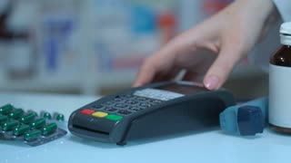 Male hand enter password on pos terminal at drugstore. Credit card payment. Close up of man enter pin cod on card terminal at pharmacy. Card paying at medical store