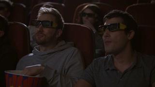 Man eating popcorn in 3d cinema. Friends taking popcorn from pop corn box. Guy giving popcorn to friend. Spectators enjoy cinema snacks