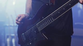 Man hand playing electric guitar. Electric guitar player hand . Close up of man hand playing string guitar. Rock guitar tuning. Rock guitarist playing playing music