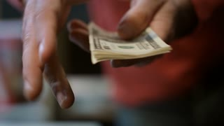 Man hands showing dollar banknotes. Close up of american cash money in male hands. Man showing family money savings. Office employee salary. Modern bank services. Cash dollars