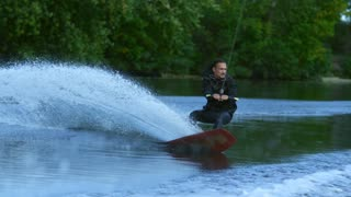 Man riding on waterski. Sportsman falling into water. Sport failing on water. Extreme sports on river. Wake boarder training on waves. Extreme lifestyle. Rider fall into water splash