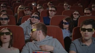 Man talking on phone in cinema hall. Uncultured man disturb people in movie theatre. Man bothering people watching 3d film in cinema. Uncultured manners at cinema