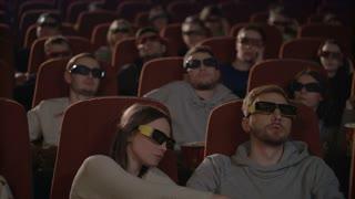Man talking on phone in cinema. Rude man speaking mobile phone and disturb people in movie theater. Irritated audience