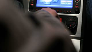 Man's hand switches manual transmission in car. Digital dashboard in car. Touchscreen control panel in auto. Close up of gear shift in auto. Car driver change gear. Gear shift knob