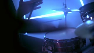 Musician playing drums and cymbals at studio. Drummer rotate drums stick in hand. Rock and roll musical show. Playing percussion instruments