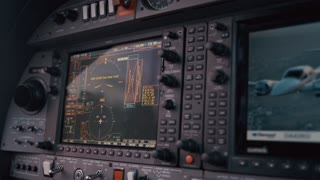 Navigation panel in airplane cockpit. Close up of female hand tuning airplane navigation system. Plane navigation panel. Female hand touching plane control panel. Airplane control panel screen. Gps