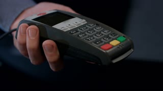 NFC terminal payment. Customer hand paying with contactless credit card with NFC technology. Banking services of electronic money. Wireless money transaction. Nfc pay terminal. Bank card transaction