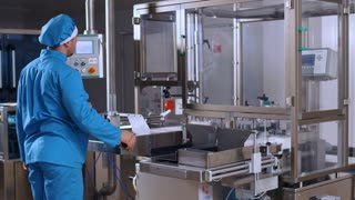 Operator control pharmaceutical manufacturing process. Pharmaceutical equipment. Quality control at pharma production line. Pharmaceutical factory interior. Pharmaceutical industry. Drug factory