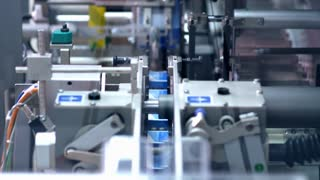 Packaging line at pharmaceutical factory. Pharmaceutical industry. Medical drugs on packaging machine. Pharmaceutical manufacturing packaging process. Pharmaceutical packaging