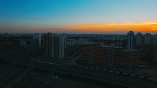 Panoramic skyline with skyscrapers and buildings at sunrise. City landscape at sunset. Night metropolitan landscape. Beautiful evening cityscape horizon. Modern architecture at sunset time