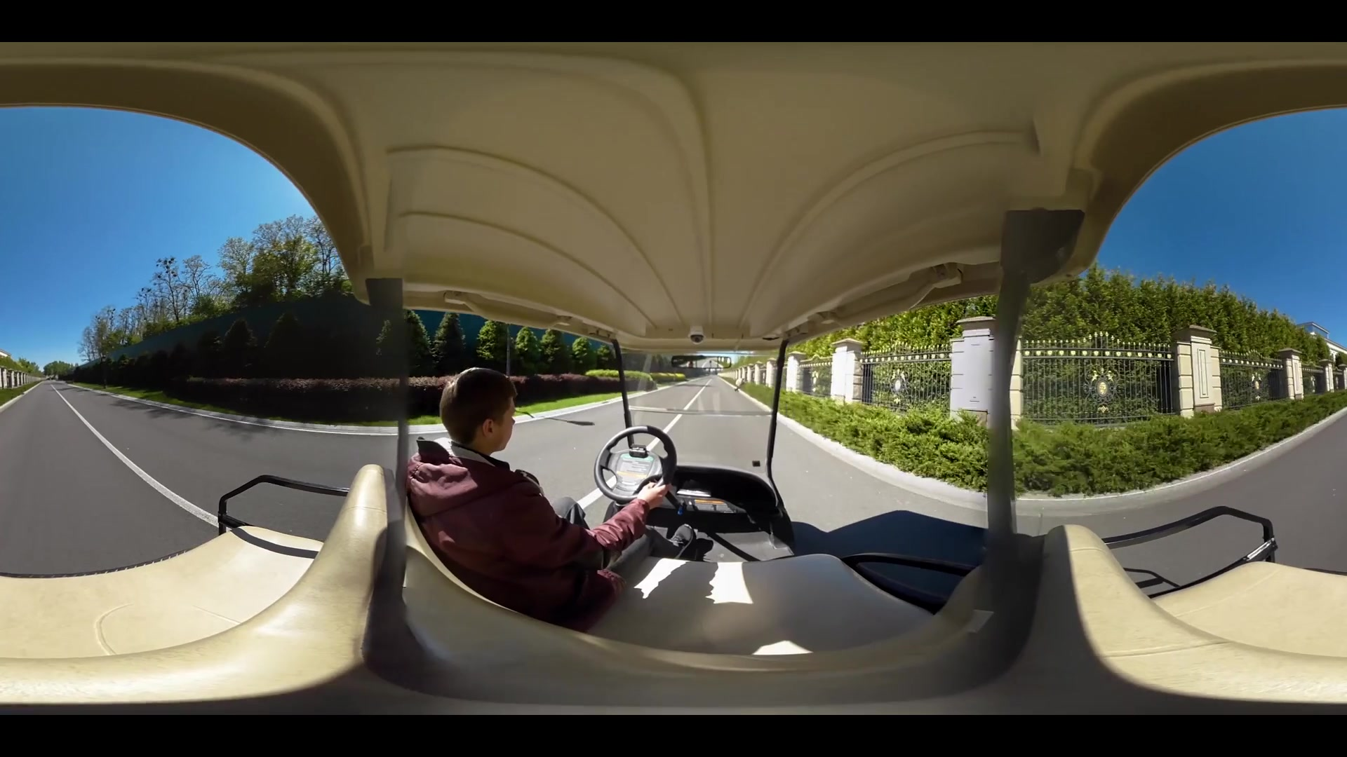 Panoramic view man driving in golf cart on road. Male golfer driving in golf cart on road 360 degree panorama. Man moving in car on territory golf club 360 video