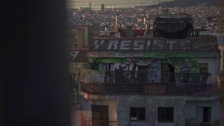 Panoramic view of Barcelona cityscape. Street art on building walls. Graffity paintings on house walls. Barcelona city sightseeings. Slow motion video of Barcelona city view