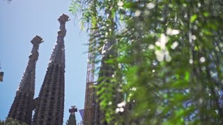 Panoramic view of La Sagrada Familia cathedral in Barcelona city. Low angle view of old catholic church in modern European city. Barcelona city sightseeings. Historical building by Antonio Gaudi