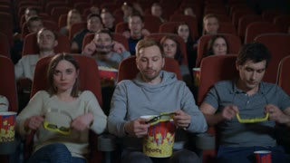 People wearing 3d movie glasses in cinema. 3d movie audience in cinema theater. Spectators wearing cinema 3d glasses in slow motion. Movie entertainment concept